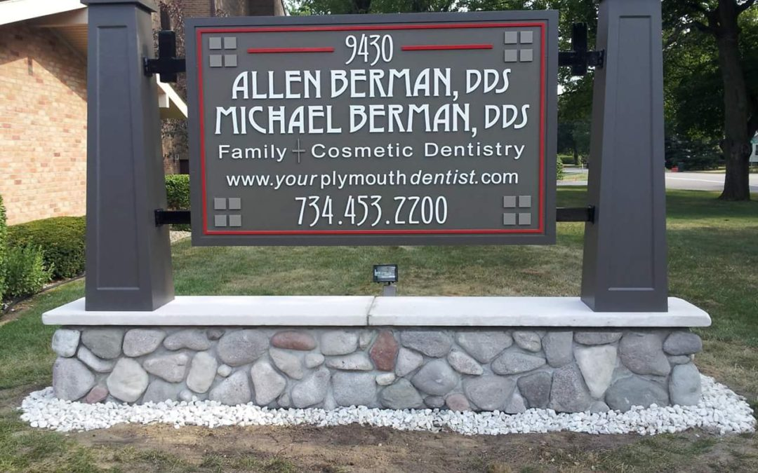 HDU carved sign, custom posts with cultured stone pedestal and limestone sill, Plymouth Michigan
